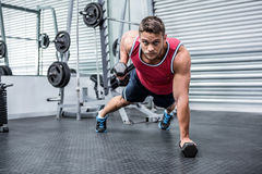 Portrait of muscular man using dumbbells Royalty Free Stock Images