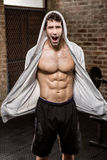Portrait of muscular man wearing hood Stock Images
