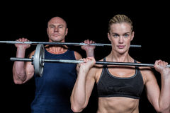 Portrait of muscular man and woman lifting crossfit Royalty Free Stock Images