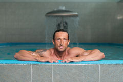 Portrait Of A Muscular Sexy Man In Underwear. Happy Attractive Muscular Mature Man Resting Relaxed On Edge Of Swimming Pool Stock Photos