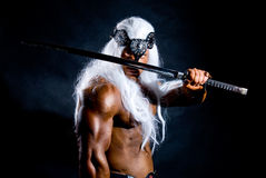 Portrait of a muscular warrior with a sword Stock Images