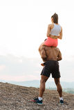 Portrait of a muscular young black african american man giving piggyback ride to his sexy girlfriend Royalty Free Stock Images