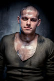 Portrait of muscular young man. With dirty face and chest Stock Photography