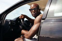 Portrait of muscular young man in car Royalty Free Stock Photos