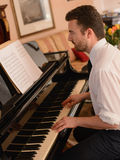 Portrait of music performer playing his piano Royalty Free Stock Image