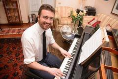 Portrait of music performer playing his piano Stock Images
