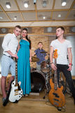 Portrait of musical group of three guys and one girl Royalty Free Stock Photos