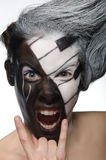 Portrait with musical makeup and rock gesture Stock Photos