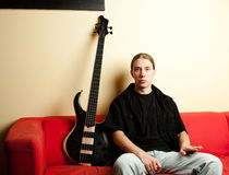 Portrait of musician with bass guitar Royalty Free Stock Images