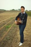 Portrait of musician. On field royalty free stock photography