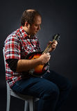 Portrait of musician with mandolin Stock Photography
