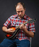 Portrait of musician with mandolin Royalty Free Stock Photo