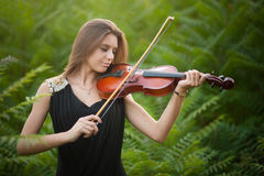 Portrait of musician. Young gilr play on viola Stock Image