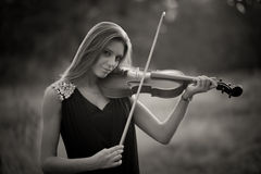 Portrait of musician. Young gilr play on viola Royalty Free Stock Image