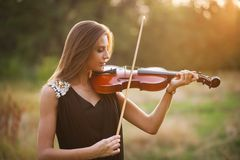 Portrait of musician. Young gilr play on viola Stock Photos