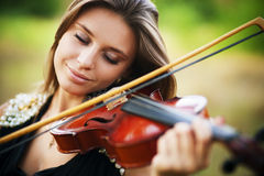 Portrait of musician. Young gilr play on viola Royalty Free Stock Photo