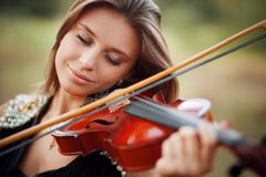 Portrait of musician. Young girl play on viola Stock Photos