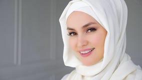Portrait of muslim arabian woman wearing hijab, looking at camera and smiling. royalty free stock photos