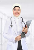 Moslem asian doctor writing on paperclip Royalty Free Stock Images