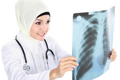 Smiling asian medical doctor looking at xray Stock Photos