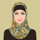 Portrait of muslim beautiful girl in patterned hijab Stock Photos