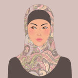 Portrait of muslim beautiful oriental girl in patterned hijab Stock Photos