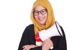 Muslim Businesswoman with Megaphone. Portrait of muslim businesswoman wearing hijab smiling while holding megaphone, leadership motivation marketing advertising Stock Image