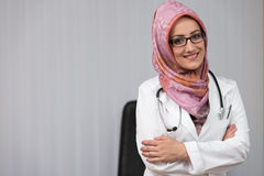 Portrait Of Muslim Doctor Standing Arms Crossed Stock Photo