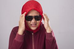 986fe90a3ab Muslim Lady in Red Having Headache. Portrait of muslim lady wearing black  sunglasses in red