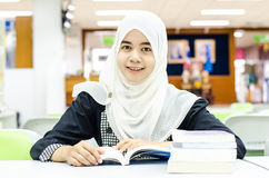 Portrait of Muslim in the library Royalty Free Stock Image