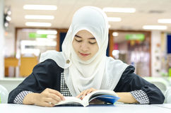 Portrait of Muslim in the library Stock Image