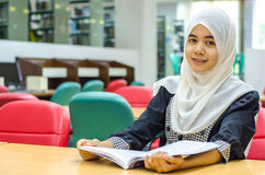 Portrait of Muslim in the library Royalty Free Stock Photos