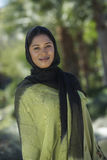 Portrait Of A Muslim Woman. Portrait of an attractive Muslim woman in traditional wear smiling Stock Image