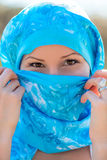 Portrait of a Muslim woman in a blue scarf Royalty Free Stock Photo