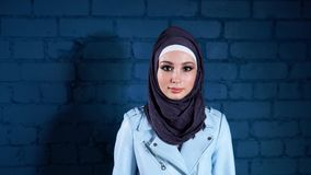 Portrait of a Muslim woman wearing a hijab, who looks confidently at the camera stock video footage