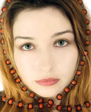 Portrait of a mysterious beautiful girl. With green eyes Stock Images