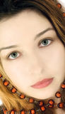Portrait of a mysterious beautiful girl. With green eyes Stock Photos