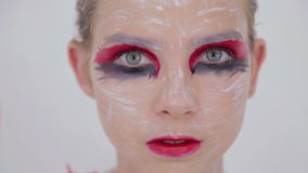 Portrait of mysterious girl with creative make-up and elegant hairstyle stock video