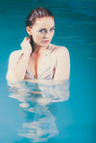 Portrait of mysterious seductive woman in water. Portrait of mysterious sexy seductive woman in swimming pool water. Pretty alluring young girl wearing wet Royalty Free Stock Photos