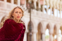 Portrait of mysterious woman in red cloak Royalty Free Stock Images