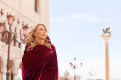 Portrait of mysterious woman in red cloak Stock Photo