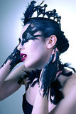 Portrait of mysterious young woman. Black swan Royalty Free Stock Photo