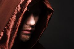 Portrait of mystery unrecognizable monk. In robe Stock Photography