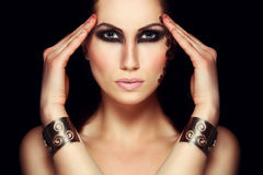 Portrait of mystic woman with extravagant makeup royalty free stock photography