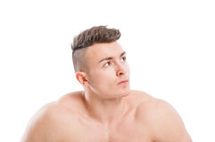 Portrait of a naked male stud. Portrait of a naked, muscular, young and handsome male model with copy space on white background Royalty Free Stock Image