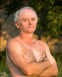 Portrait of naked man. On natural background Royalty Free Stock Image