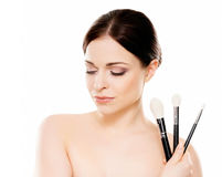 Portrait of a naked woman with makeup brushes Royalty Free Stock Images