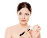 Portrait of a naked woman with makeup brushes Stock Photography