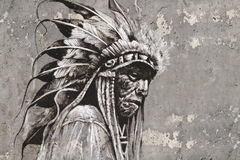 Portrait of native american indian head over textured wall Royalty Free Stock Images