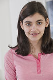 Portrait of native american pre-teenage girl at home. Portrait of native american pre-teen girl with braces on her teeth wearing casual clothes and looking Stock Images